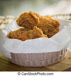 fried chicken - Fried Chicken in a basket on a wooden floor
