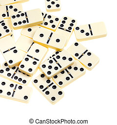 above view of many scattered dominoes isolated on white...