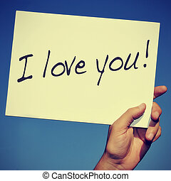 I love you - a man hand holding a signboard with the...