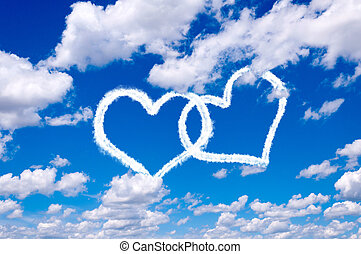 Love in the air concept with heart shape clouds