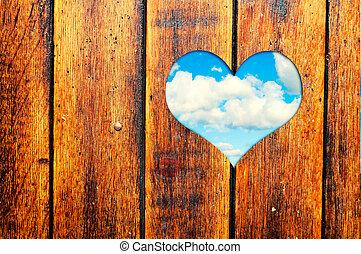 Heart shape - Wooden background with heart shape window