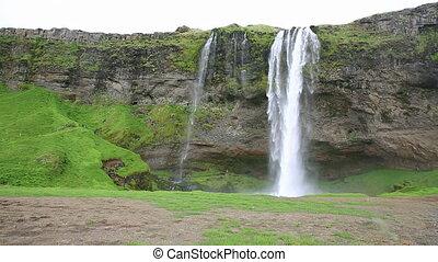 Seljalandsfoss waterfall - Wide angle view of Seljalandsfoss...