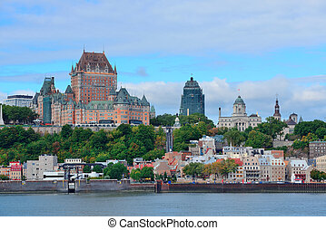 Quebec City skyline over river with blue sky and cloud