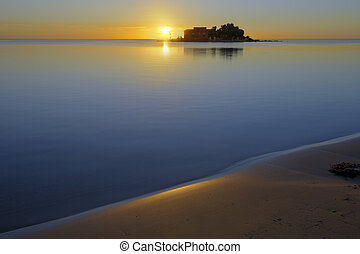 Beach sunrise - Sunrise on an empty beach and a calm sea