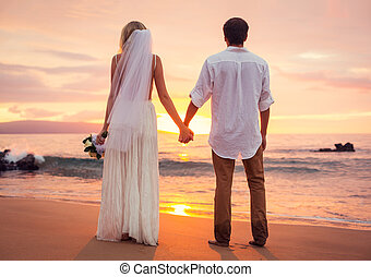 Married couple, bride and groom at sunset on beautiful...