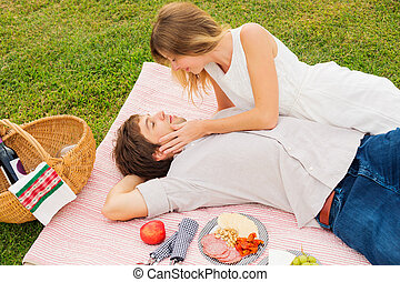 Couple Enjoying Romantic Sunset Picnic - Attractive Couple...