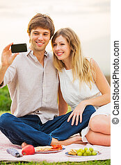 Couple Taking Selfie With Mobile Phone Outdoors