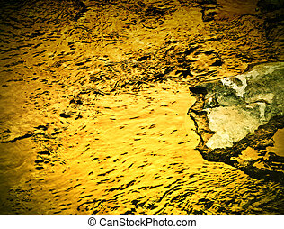 golden water level - background or texture golden water...
