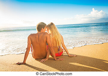 Couple Watching the Sunset on Tropical Beach Vacation -...