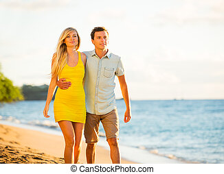 Couple Walking on the beach at Sunset, Romantic Vacation