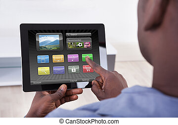 Person Holding Digital Tablet - Close-up Of African Person...