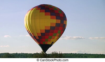 Hot Air Balloon Takes Flight - Single hot air balloon takes...