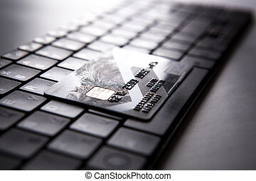 bank card on a keyboard close-up