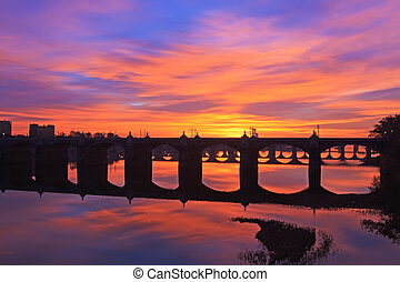 Sunrise at Harrisburg - A colorful sunrise over the many old...