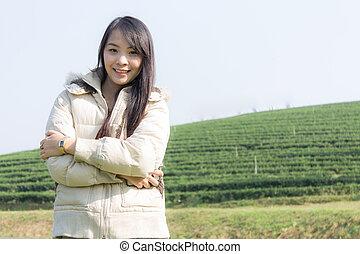 Portrait Thai woman in tea plantation , Chiangrai Thailand
