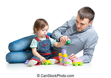 baby girl and father play toys together