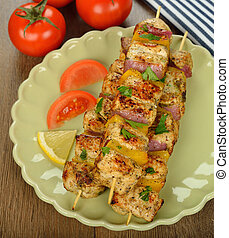 chicken kebabs on a brown background
