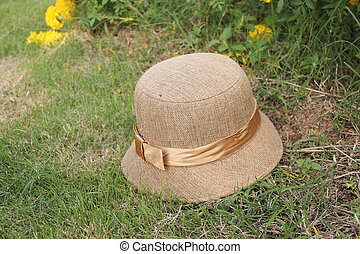 a straw hat on the grass