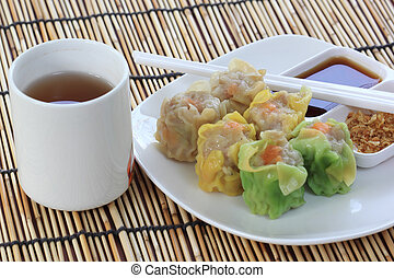 Chinese Streamed Dumpling in the plate and cup of Tea