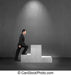 Businessman climbing on podium with spot lighting
