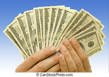 money in hands - money concept dollars in hands over blue...