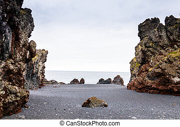 Icelandic beach with black lava rocks, Snaefellsnes...