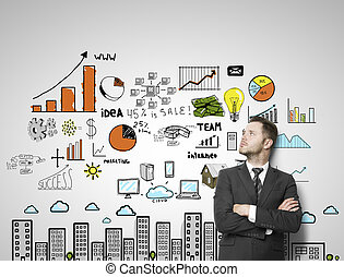 color business strategy - businessman leaning against a...