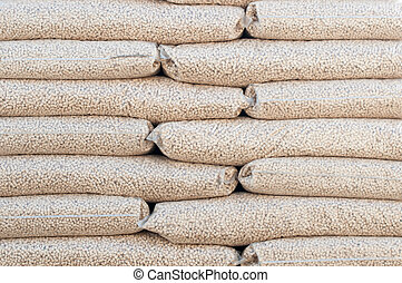 Pellets- Biomass - Heap of stacks of Pine pellets - stock...