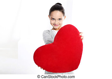 Portrait of a girl with a big heart - Cute Caucasian girl...