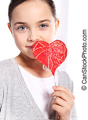 Valentine heart - Cute Caucasian girl holding a red...
