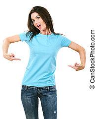 Brunette pointing at her blank light blue shirt