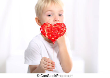 valentine boy - Little caucasian boy shows a red Valentine...