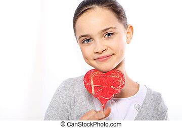 Portrait of a girl with red heart s - Cute Caucasian girl...