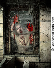 Undead at the window - Photo of a hungry zombie covered with...