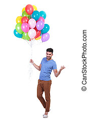 man holding a bunch of balloons is inviting to party - happy...