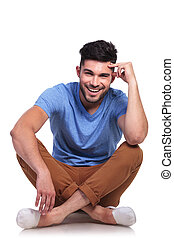 young pensive casual man sitting relaxed