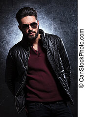 relaxed fashion man in sunglasses and leather jacket