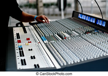 A hands above audio mixer console - A hands above...