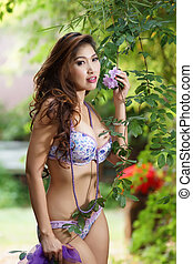 Beautiful Asian woman in lingerie voluptuous posing...