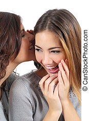 Two gossip teenager girls telling a secret isolated on a...