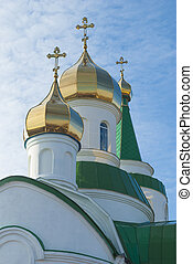 Domes of orthodox temple against the sky.