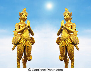 Golden Thai style statues acting Wai or Sawasdee - Golden...