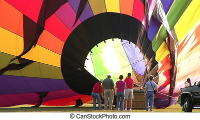 Hot Air Balloon Inflation - A ground crew works to get their...