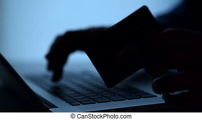 Using credit card on-line. Silhouette.