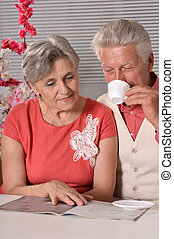 Nice elderly couple resting at home