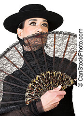 Spanish Dancer in a black costume with hat and accessories