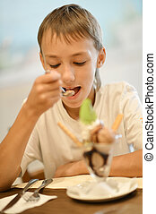 boy eating ice cream - Young boy eating ice cream