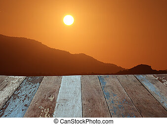 Grunge wooden floor with sunrise sky background