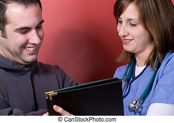 At The Doctor - A young nurse sharing results with her...