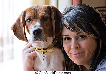 Woman And Her Dog - A pretty young woman posing with her...